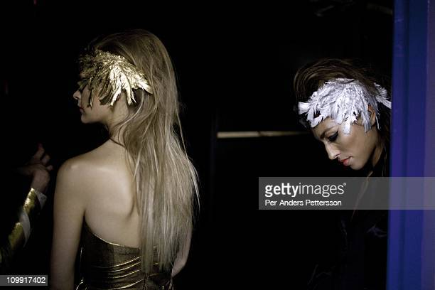 Models prepare backstage before a show for the designer Spero Villiotti at the Bus Factory at Joburg Fashion Week on February 18 in Johannesburg...