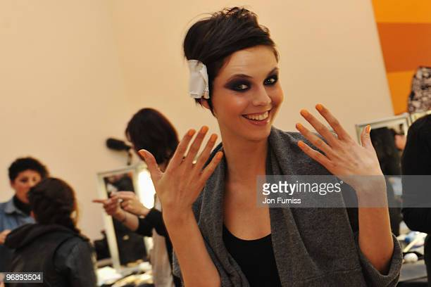 Models prepare backstage before appearing on the runway at the Look Magazine Show for High Street retailers held at the Saatchi Gallery on February...