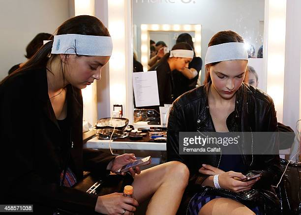 Models prepare backstage before the 2nd Floor fashion show during Sao Paulo Fashion Week Winter 2015 at Parque Candido Portinari on November 7 2014...