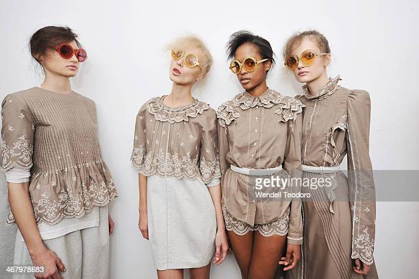Models prepare backstage before the Alexandre Herchcovitch show during MADE Fashion Week Fall 2014 at Milk Studios on February 8, 2014 in New York...