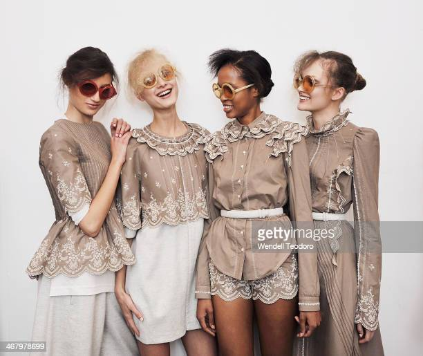Models prepare backstage before the Alexandre Herchcovitch show during MADE Fashion Week Fall 2014 at Milk Studios on February 8 2014 in New York City