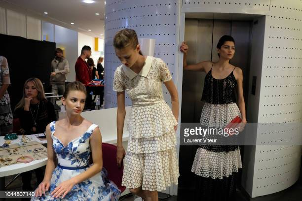 Models prepare backstage before the Christophe Guillarme show as part of the Paris Fashion Week Womenswear Spring/Summer 2019 on October 2, 2018 in...