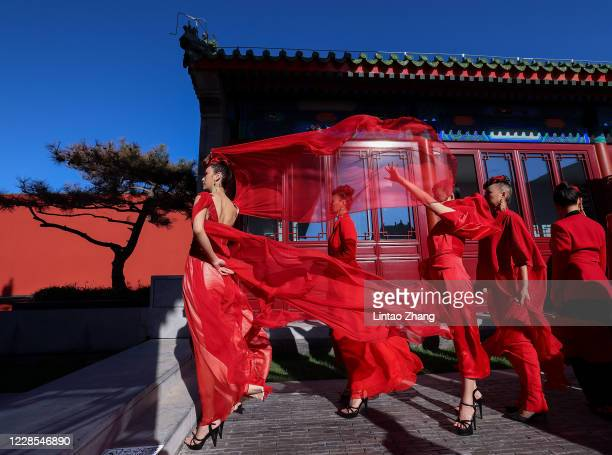 "Models prepare backstage before the ""idol lady2020"" collection show during the day two of Beijing Fashion Week at Longfu Culture Center on September..."