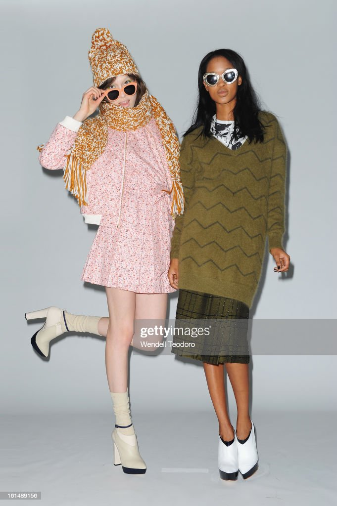 Models prepare backstage before the Karen Walker show during Fall 2013 Mercedes-Benz Fashion Week at Pier 59 on February 11, 2013 in New York City.