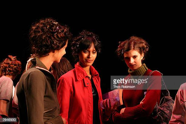 Models prepare backstage during Olympus Fashion Week at Bryant Park February 8 2004 in New York City