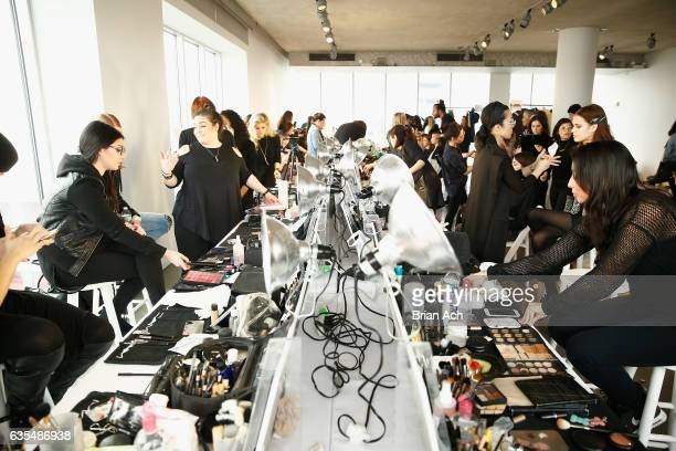 Models prepare backstage during the Brooks Brothers FW 2017 Presentation with Zac Posen at The Glasshouses on February 15 2017 in New York City