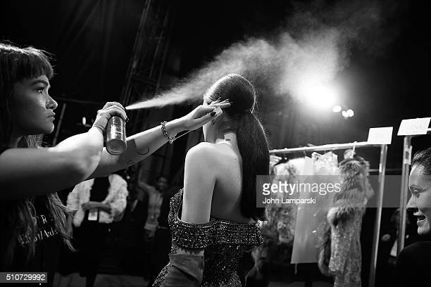 Models prepare backstage during the Dennis Basso Fall 2016 show New York Fashion Week: The Shows at The Arc, Skylight at Moynihan Station on February...