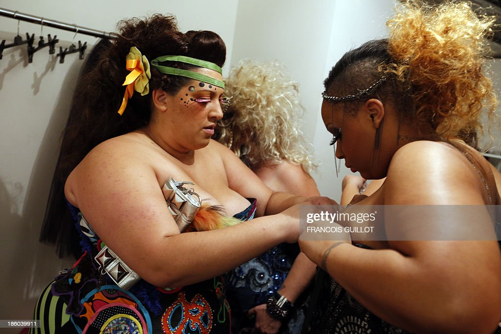 Models prepare backstage during the first Pulp fashion week, on October 27, 2013 in Paris.