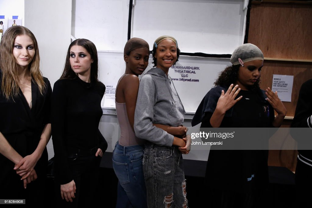 Models prepare backstage during the Leanne Marshall show during February 2018 New York Fashion Week: The Shows at Gallery II at Spring Studios on February 14, 2018 in New York City.