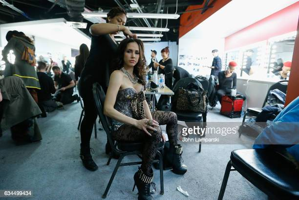 Models prepare backstage during the Popoganda By Richie Rich during New York Fashion Week at The Theater at Madison Square Garden on February 9 2017...