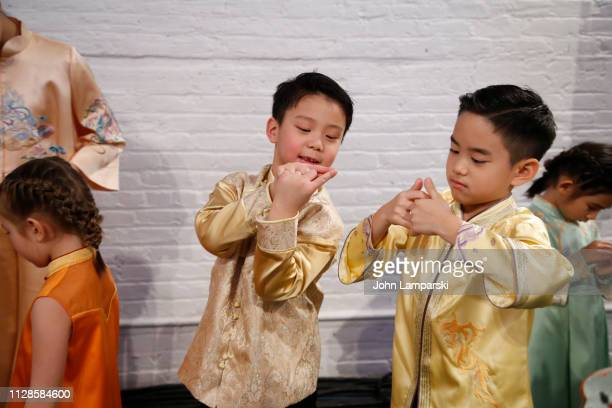 Models prepare backstage for Amelie Wang during New York Fashion Week The Shows at Industria Studios on February 09 2019 in New York City