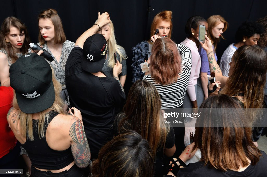 Models prepare backstage for Calvin Luo during New York Fashion Week: The Shows at Gallery I at Spring Studios on September 12, 2018 in New York City.