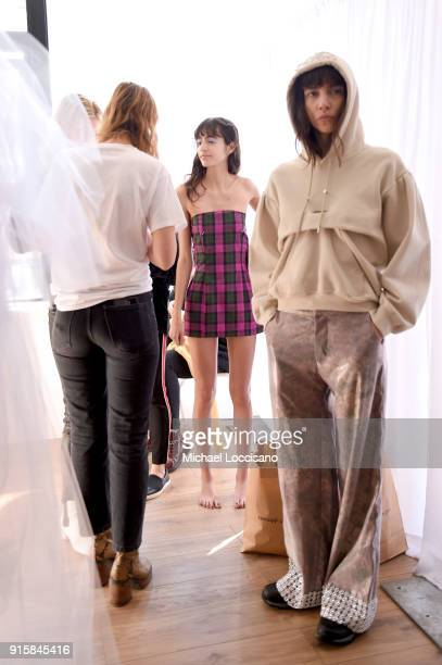 Models prepare backstage for Collina Strada during New York Fashion Week on February 8 2018 in New York City