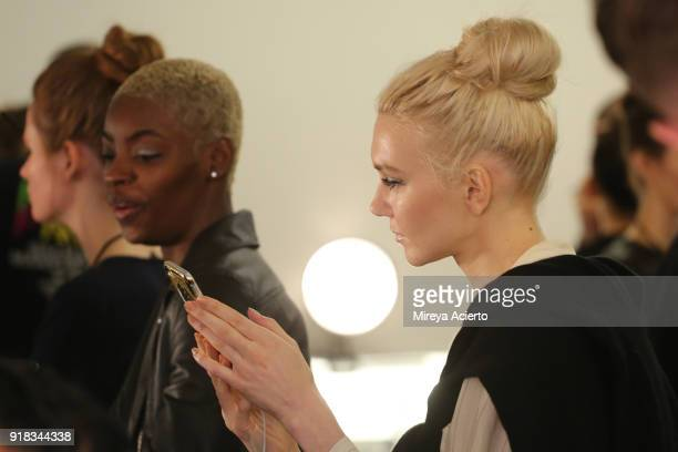 Models prepare backstage for Irina Vitjaz during New York Fashion Week The Shows at Gallery I at Spring Studios on February 14 2018 in New York City