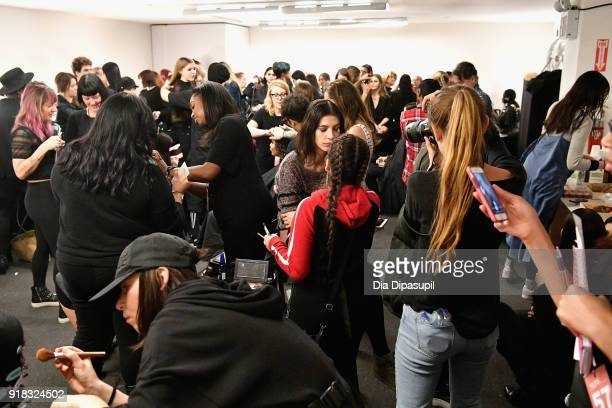Models prepare backstage for Leanne Marshall during New York Fashion Week The Shows at Gallery II at Spring Studios on February 14 2018 in New York...