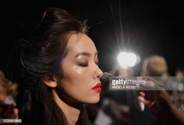Models prepare backstage for the ESCADA Spring/Summer 2019 show at Park Avenue Armory on September 9 2018 in Brooklyn New York