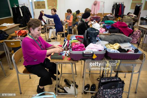 Models prepare backstage for the Gamo Colle or Sugamo Collection 2017 show on November 19 2017 in Tokyo Japan About 22 models aged between 50 and 78...