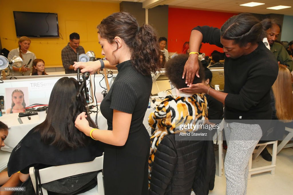 Models prepare backstage for TRESemme At Carolina Herrera during New York Fashion Week on September 10, 2018 in New York City.