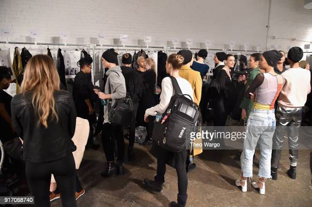 Models prepare backstage for Vivi Zubedi during New York Fashion Week The Shows at Industria Studios on February 11 2018 in New York City