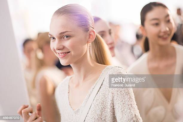 Models prepare backstage prior the Allude show as part of the Paris Fashion Week Womenswear Spring/Summer 2015 on October 1 2014 in Paris France