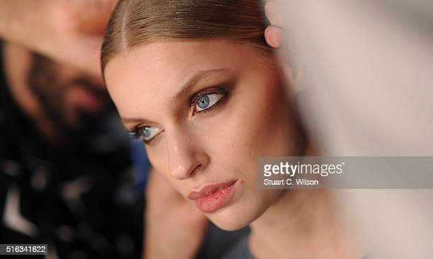 Models prepare backstage prior to the Derya Acikgoz show during the MercedesBenz Fashion Week Istanbul Autumn/Winter 2016 at Zorlu Center on March 18...