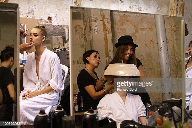 Models prepare backstage prior to the Jantaminiau show as part of Paris Fashion Week Fall/Winter 2011 at BETC EURO RSCG on July 7, 2010 in Paris,...