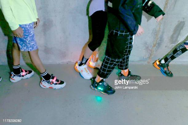 Models prepare backstage, sneaker detail, for China Day: Anta Kids during New York Fashion Week: The Shows on September 08, 2019 in New York City.