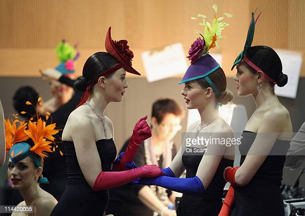 Models prepare before a fashion show featuring outfits by British and Irish designers at the Convention Centre Dublin watched by Queen Elizabeth II...