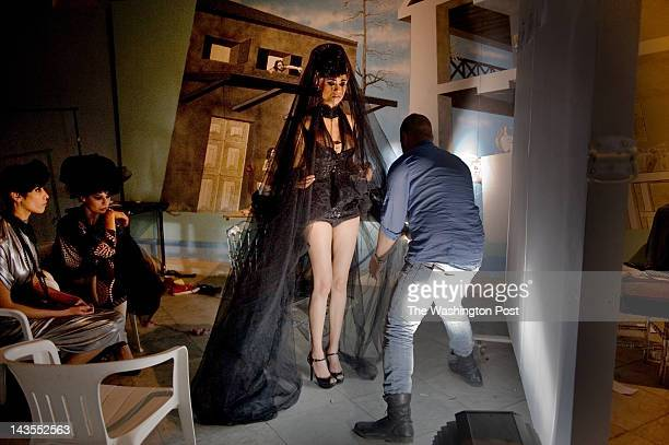 Models prepare for Tunisian designer Soucha Mlihigue to close out Fashion Week Tunis in Carthage Tunisia on Saturday April 14 2012 Black tulle veils...