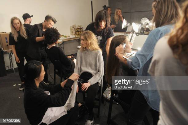 Models prepare in the backstage hair and makeup stations during IMG NYFW The Shows at Spring Studios on February 11 2018 in New York City
