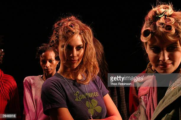 Models prepare on the runway during Olympus Fashion Week at Bryant Park February 8 2004 in New York City
