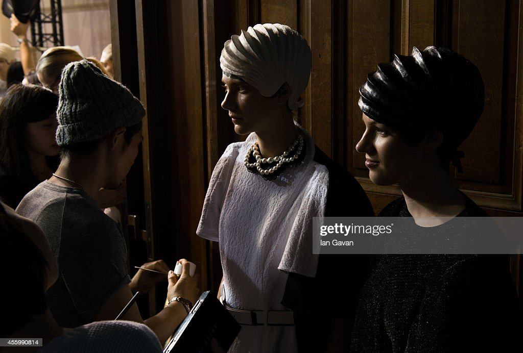Models prepare prior the Anrealage show as part of the Paris Fashion Week Womenswear Spring/Summer 2015 on September 23, 2014 in Paris, France.