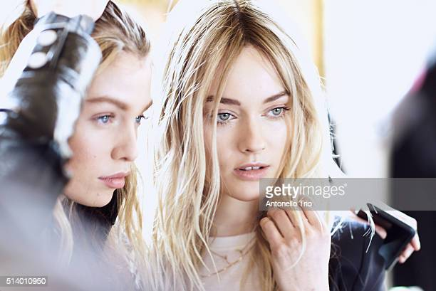 Models prepares backstage before the Balmain show as part of the Paris Fashion Week Womenswear Fall/Winter 2016/2017 on March 3 2016 in Paris France