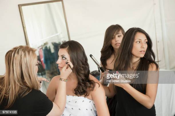 Models preparing for fashion show