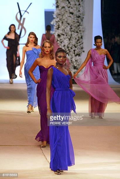 Models present 2002 creations for French designer Yves Saint Laurent, 22 January 2002, during Saint Laurent's last ever show at the Centre Georges...