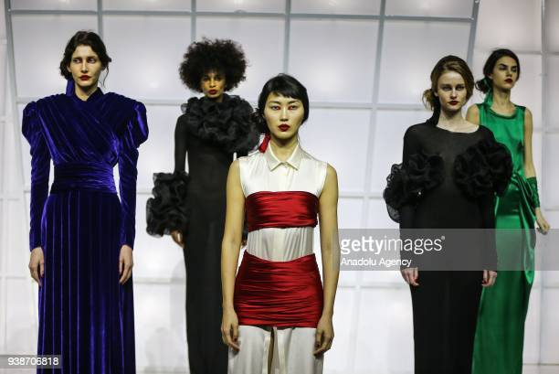Models present a collection by Ece Kavran to advertise her new brand 'URUN' within Mercedes Benz Fashion Week 2018 in Istanbul Turkey on March 27 2018