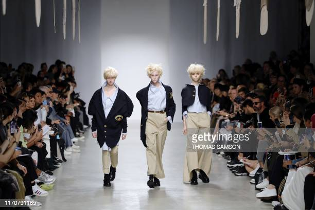 TOPSHOT Models present a creation by Anrealage during the Women's SpringSummer 2020 ReadytoWear collection fashion show in Paris on September 24 2019