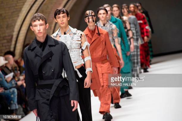 Models present a creation by British designer Craig Green during their catwalk show on the final day of the Autumn/Winter 2019 London Fashion Week...