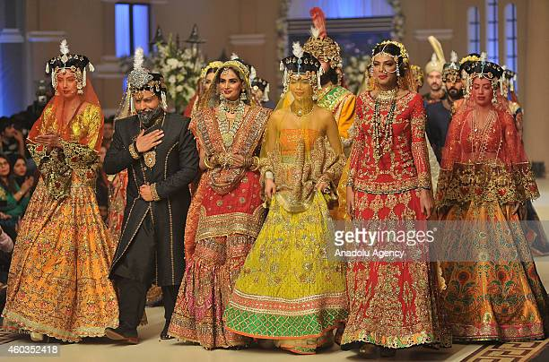 Models present a creation by designer Ali Xeeshan on first day of Bridal Couture Fashion Week in Lahore Pakistan on December 11 2014