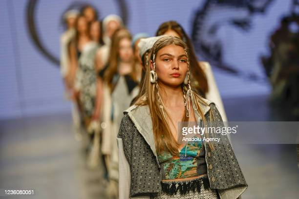 Models present a creation by Gerda Irene during the last day of the Mercedes-Benz Fashion Week at the Museum of Moscow in Moscow, Russia on October...