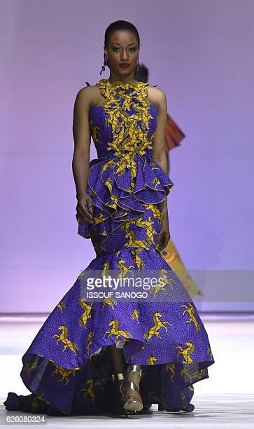 Models present a creation by label Celine Koby during a fashion show marking the 170th anniversary of Dutch manufacturer of African luxury VLISCO in...