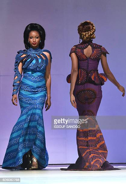 Models present a creation by label Esther K during a fashion show marking the 170th anniversary of Dutch manufacturer of African luxury VLISCO in...
