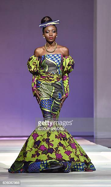 Models present a creation by label Patricia Waota during a fashion show marking the 170th anniversary of Dutch manufacturer of African luxury VLISCO...