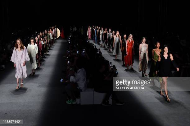 Models present a creation by Lilly Sarti during the Sao Paulo Fashion Week in Sao Paulo Brazil on April 23 2019