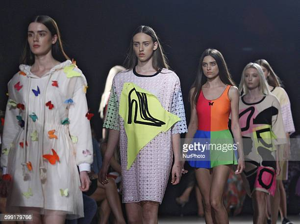 Models present a creation by Lithuania designer Agne Kuzmickaite during the MercedesBenz Kiev Fashion Days in Kiev Ukraine03 September2016 The event...