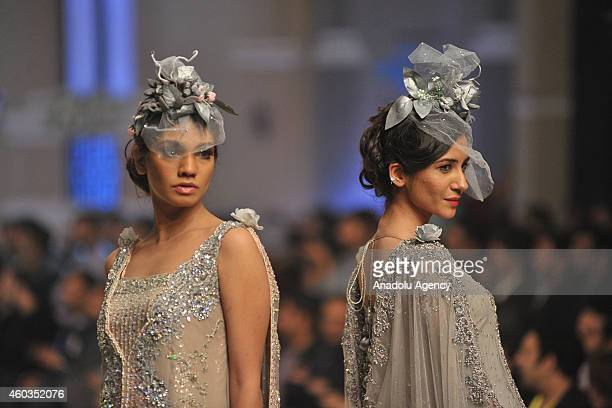 Models present a creation by Pakistani designer MariaB on first day of Bridal Couture Fashion Week in Lahore Pakistan on December 11 2014