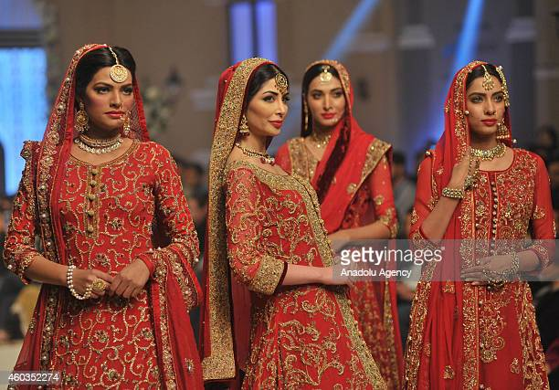 Models present a creation by Pakistani designer Ziggi on first day of Bridal Couture Fashion Week in Lahore Pakistan on December 11 2014