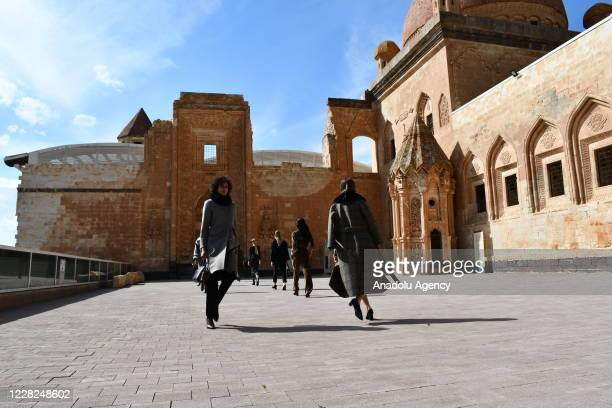 Models present a creation during Dosso Dossi 2020-21 Winter Creation Digital Platform Fashion Show at the Ishak Pasha Palace, a semi-ruined palace...