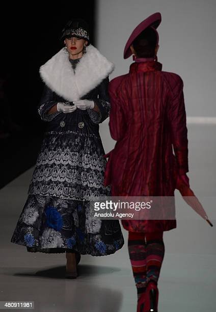 Models present a creation of designer Slava Zaitsen's collection for 2014 Autumn / Winter during the MercedesBenz Fashion Week Russia at Manezh...