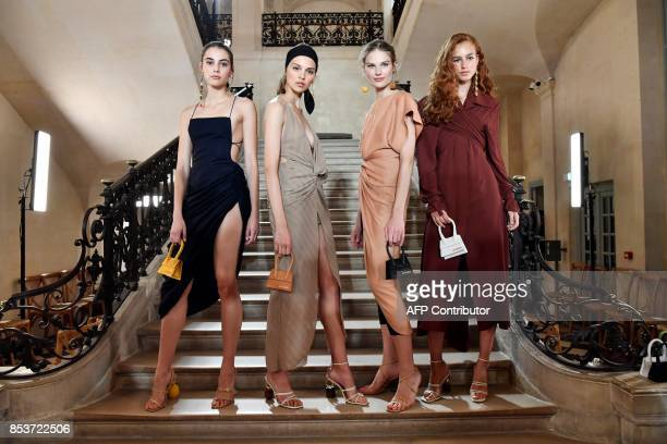 TOPSHOT Models present a creation of Jacquemus fashion house as part of the Paris 2017 Spring/Summer readytowear collection fashion show on September...